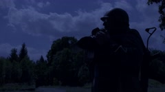 Soldier is using a field telephone at night Stock Footage
