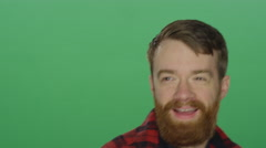 Bearded man smiling and dancing, on a green screen background Stock Footage