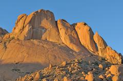 Rock formations at Spitzkoppe in Namibia at sunset Stock Photos