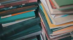 Stack of Books in the Library Stock Footage