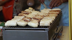 Grill banana, local popular street food at night and day market of Thailand Stock Footage