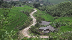Children walking through the rice terraces valley in Sapa maui Chau Vietnam Stock Footage
