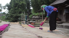 Vietnamese traditional artist woman drying sticks for craft in Sapa Vietnam Stock Footage