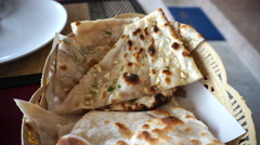 Indian food. Naan pancake flour and garlic taste Stock Footage