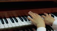 A woman playing the organ Stock Footage