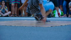Dancer demonstrates elements of break dance in the street, style of street dance Stock Footage