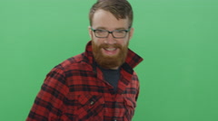 Bearded man dancing and being playful, on a green screen background Stock Footage