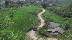 Truck driving through the rice terraces valley in Sapa Vietnam Stock Footage
