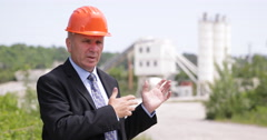 TV Reporter Talking Front of Camera About Concrete Factory Business Opportunity Stock Footage