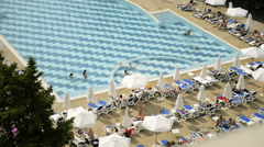 People Relaxing at an Outdoor Pool during Summer Stock Footage