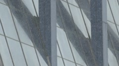 Background. Winter. Very fine snow on a background of mirrored Windows. Stock Footage