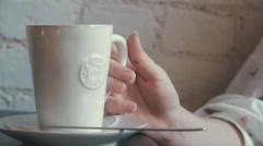 Close up shot coffe cup in a cafe girl taking and drinking Stock Footage