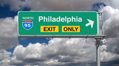 Philadelphia Interstate 95 Exit  Sign with Time Lapse Clouds Stock Footage