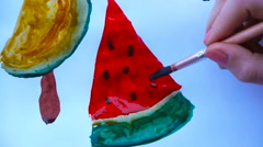 Person draws the brush a slice of watermelon, watermelon seeds, still-life Stock Footage