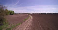 The road through the plowed field Stock Footage