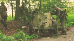 Soldiers are setting up an anti tank gun within a gas attack Stock Footage