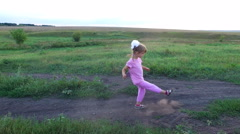 Girl child trains his leg. Little girl trains a kick. Stock Footage