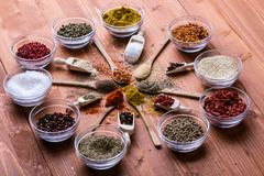 Diferent color spices on wooden table Stock Photos