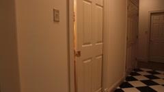 Leaving bathroom in hazmat suit Stock Footage