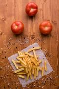 Fries on a wooden table with seasoning Stock Photos