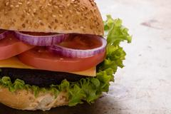 Hamburger on steel plate Stock Photos