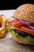 Hamburger on steel plate with fries Stock Photos