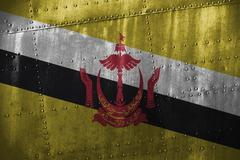 Metal texutre or background with Brunei Darussalam flag Stock Photos