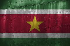 Metal texutre or background with Suriname flag Stock Photos