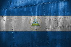 Metal texutre or background with Nicaragua flag Stock Photos