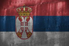 Metal texutre or background with Serbia flag Stock Photos