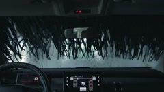 Automatic car wash brushes during washing process Stock Footage