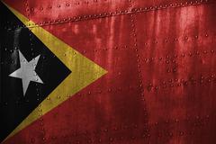 Metal texutre or background with Timor-Leste flag Stock Photos