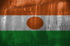 Metal texutre or background with Niger flag Stock Photos
