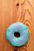 Donut with turquoise frosting Stock Photos