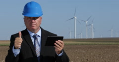 Wind Turbines Power Plant Manager Use Tablet Make Thumbs Up Looking to Camera Stock Footage
