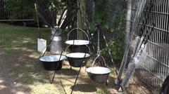 4k Traditional Harz metal hanging cooking-pots presentation Stock Footage
