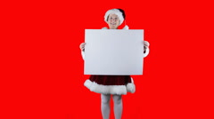Christmas Mrs Claus with white sign on red Stock Footage