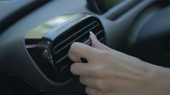 Woman adjusting automobile air conductor system Stock Footage