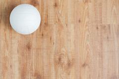 Close up of volleyball ball on wooden floor Kuvituskuvat