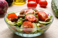 Vegetable salad in glass bowl Stock Photos