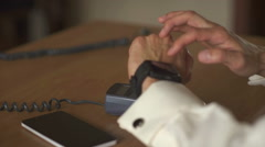 Man using smart watch to express pay on a wooden table Stock Footage