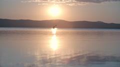 Kayaking on Calm Water at Sunset Stock Footage