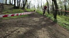 Man mountainbiker rides on a sports bicycle on a forest trail Stock Footage