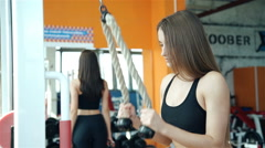 Women working out lifting weights.20s. 1080p Slow Motion Stock Footage