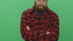 Bearded man shows an array of emotions, on a green screen background Stock Footage