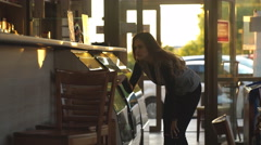 Girl chooses pastries in the window Stock Footage