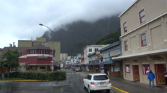 Franklin Street Juneau AK looking north rainy day traffic Stock Footage