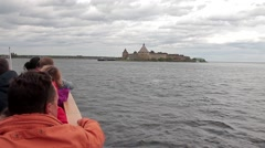 Tourists floating on a boat to the fortress Stock Footage