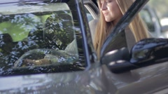 Young female driver getting in the car Stock Footage