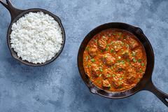 Beef Madras curry slow cook Indian spicy sauce garam masala lamb food in cast Stock Photos